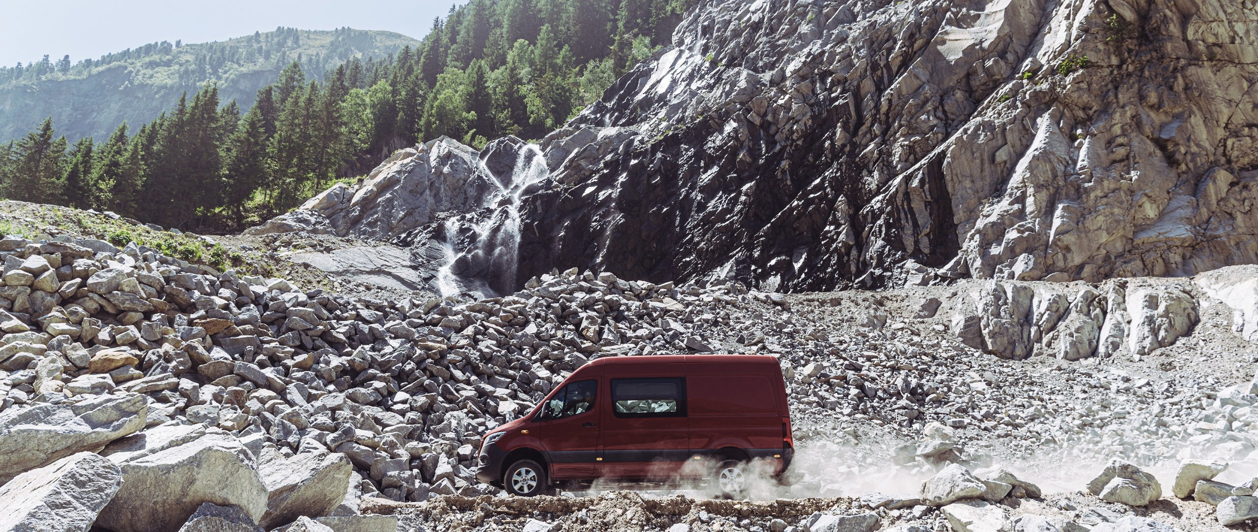 The new Mercedes-Benz Sprinter from the side in a rocky landscape
